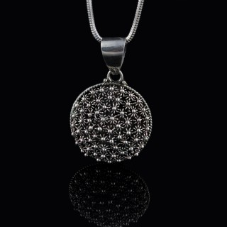 Silver pendant with ornaments